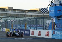Oliver Rowland crosses the finish line to win Wednesday's Formula E event in Berlin, Germany. (Andrew Ferraro / LAT Images Photo)