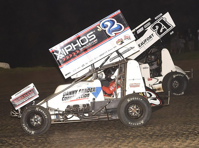 John Carney II (2) battles Robbie Price on Wednesday night at Caney Valley Speedway. (Paul Arch Photo)