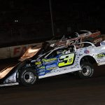 Brian Shirley (3s) battles Ryan Unzicker Wednesday night at Fairbury Speedway. (Jim Denhamer Photo)