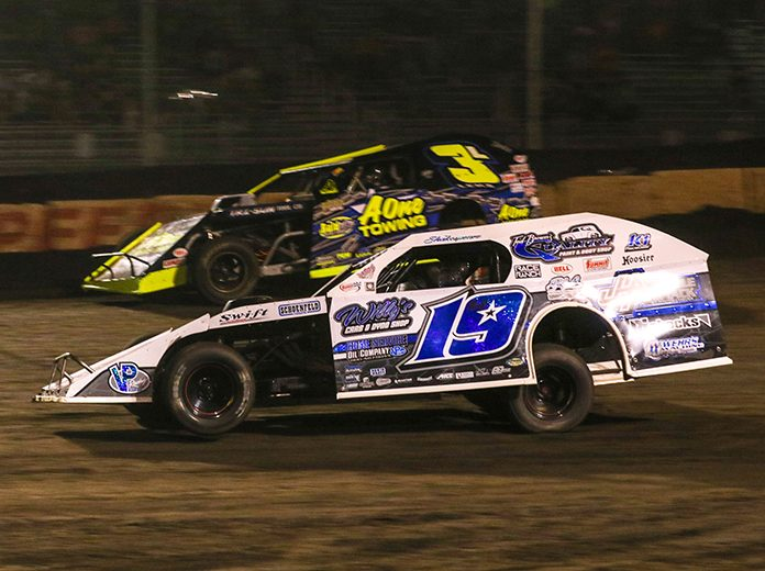 Will Krup (19) drives by Jeff Leka during Wednesday's DIRTcar Summit Racing Equipment Modified Nationals feature at Fairbury Speedway. (Brendon Bauman Photo)