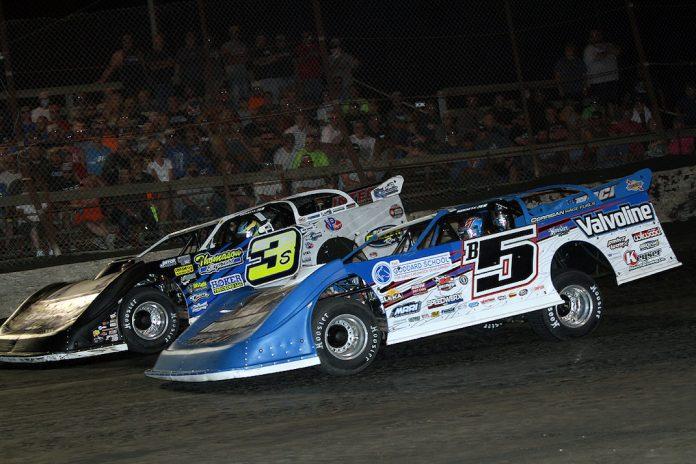 Brandon Sheppard (b5) battles Brian Shirley at Macon Speedway. (Jim DenHamer photo)