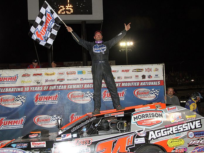 Mike Harrison celebrates his victory in Thursday's DIRTcar Summit Modified Nationals event at Macon Speedway. (Jim Denhamer Photo)