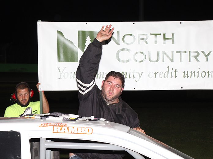 Sean McCarthy emerges from his steed after winning the Burnett Scrap Metals Road Warrior Challenge on NorthCountry Federal Credit Union Night. (Alan Ward photo)