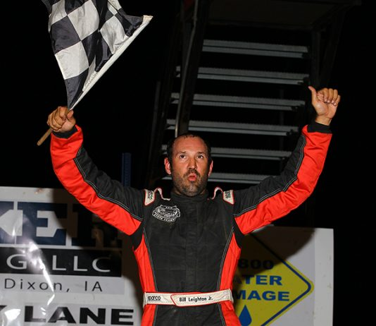 Bill Leighton celebrates his victory Saturday night at Davenport Speedway. (Mike Ruefer Photo)