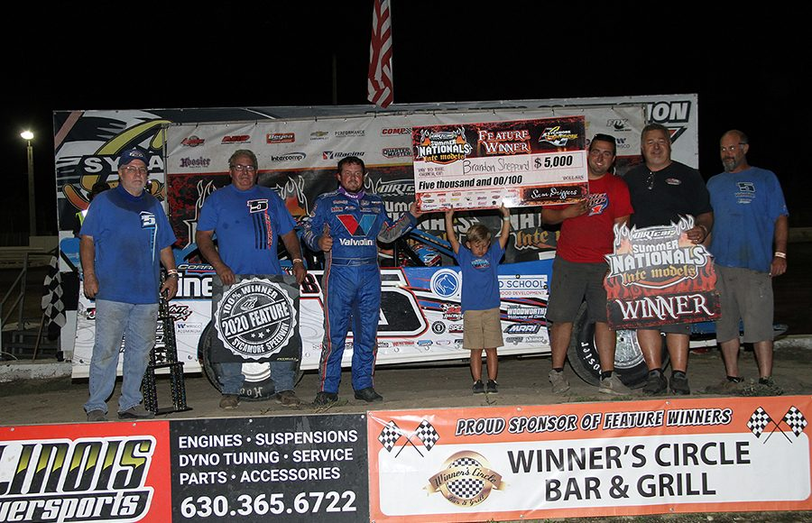 Brandon Sheppard is joined in victory lane by his team after winning Tuesday's DIRTcar Summer Nationals feature at Sycamore Speedway. (Jim Denhamer Photo)