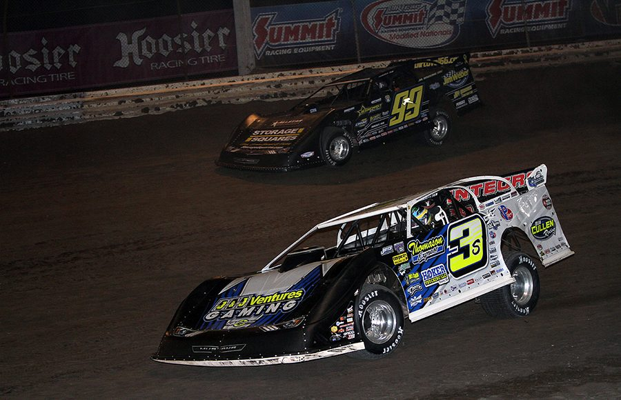 Brian Shirley (3s) races under Frank Heckenast Jr. during Tuesday's DIRTcar Summer Nationals event at Sycamore Speedway. (Jim Denhamer Photo)