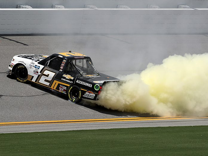 Sheldon Creed celebrates with a burnout after winning Sunday's NASCAR Gander RV & Outdoors Truck Series race on the Daytona Int'l Speedway Road Course. (Chris Graythen/Getty Images Photo)