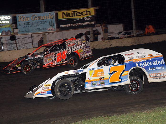 Nick Hoffman (7) battles under Mike Harrison Sunday night at Lincoln Speedway. (Jim Denhamer Photo)