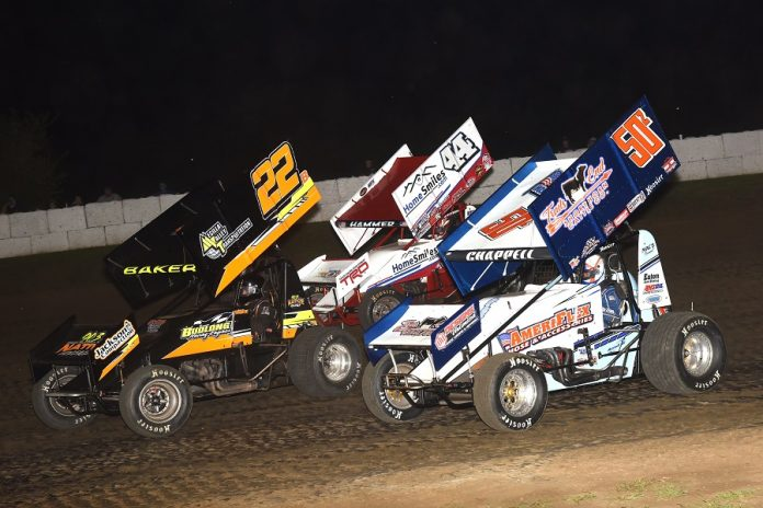 Jesse Baker (22) races ahead of Zach Chappell and Jesse Love (44) during Wednesday's ASCS Sprint Week round at Caney Valley Speedway. (Paul Arch photo)