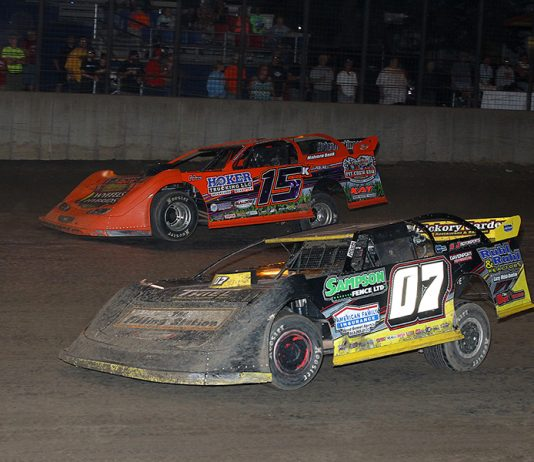 Matt Ryan (07) battles alongside Justin Kay during Saturday's Hoker Trucking Super Late Model East Series event at Davenport Speedway. (Mike Ruefer Photo)