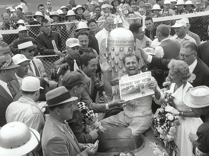 Bob Sweikert, shown here after winning the 1955 Indianapolis 500, won the inaugural Hoosier Hundred in 1953. (IMS Archives Photo)
