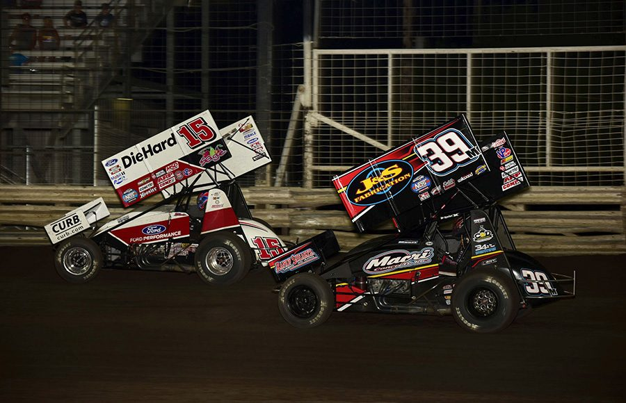 Donny Schatz (15) battles Anthony Macri during Friday's The One and Only event at Knoxville Raceway. (Mark Funderburk Photo)