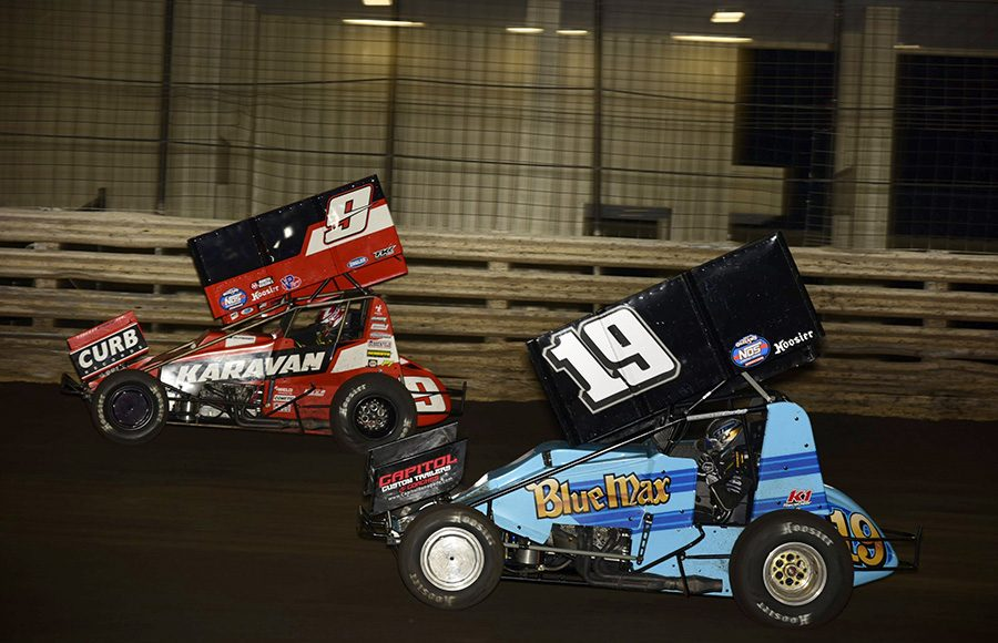 Shane Stewart (19) chases James McFadden during Friday's The One and Only event at Knoxville Raceway. (Mark Funderburk Photo)