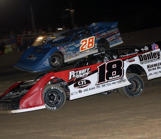 Shannon Babb (18) battles Dennis Erb Jr. during Friday's DIRTcar Summer Nationals feature at Fayette County Speedway. (Jim Denhamer Photo)