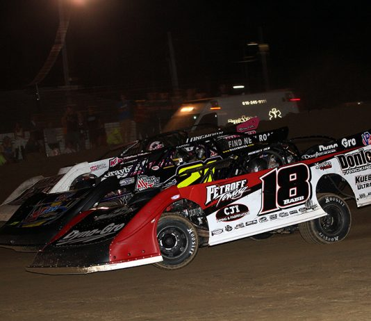 Shannon Babb (18), Billy Moyer (21) and Bob Gardner battle three-wide during Friday's DIRTcar Summer Nationals feature at Fayette County Speedway. (Jim Denhamer Photo)