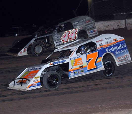 Nick Hoffman (7) races under K.C. Burdette during Thursday's DIRTcar Summit Racing Equipment Modified Nationals feature at Thunderbird Raceway. (Jim Denhamer Photo)