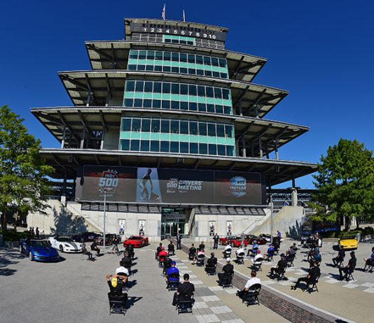 Drivers sit six feet apart during the driver's meeting for the 104th Indianapolis 500 Saturday afternoon. (Walt Kuhn/IndyCar Photo)