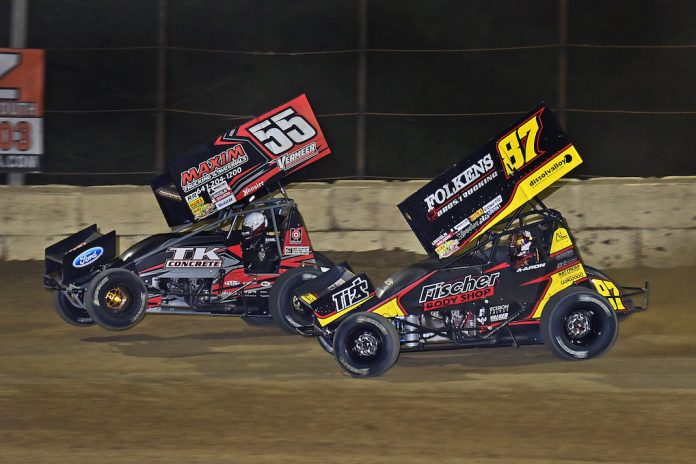 Aaron Reutzel (87) and Hunter Schurenberg battle for the lead at Plymouth Speedway. (Mike Campbell photo)