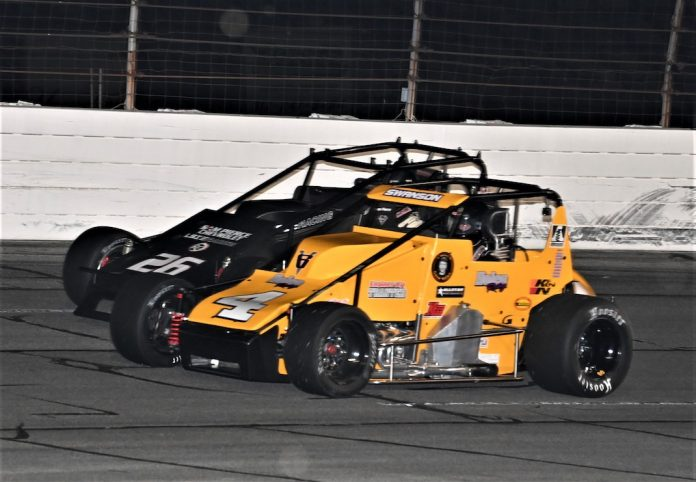 Kody Swanson (4) races under Aaron Pierce at Lucas Oil Raceway. (Al Steinberg photo)