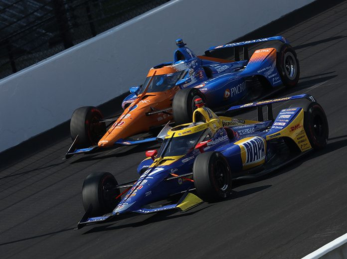 Alexander Rossi (27) battles Scott Dixon for the race lead Sunday at Indianapolis Motor Speedway. (IndyCar Photo)