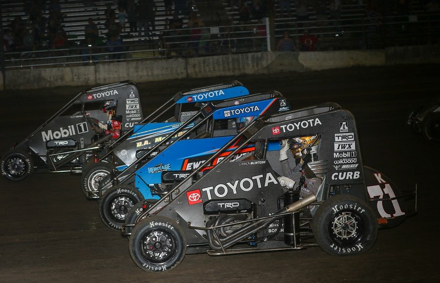 Buddy Kofoid (67) and Cannon McIntosh (71k) split traffic four-wide during Friday's POWRi Lucas Oil National Midget League event at Lincoln (Ill.) Speedway. (Brendon Bauman photo)