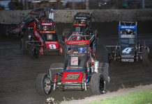 Ace McCarthy leads a gaggle of cars during Friday's POWRi Lucas Oil National Midget League event at Lincoln (Ill.) Speedway. (Brendon Bauman photo)