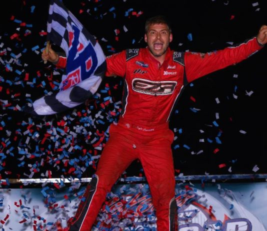 Kyle Cummins celebrates victory at Kokomo Speedway. (Rich Forman photo)
