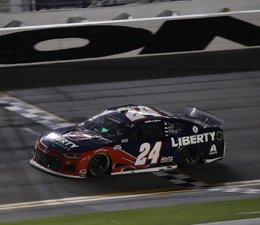 William Byron crosses the finish line to win his first NASCAR Cup Series race Saturday at Daytona Int'l Speedway. (HHP/Harold Hinson Photo)