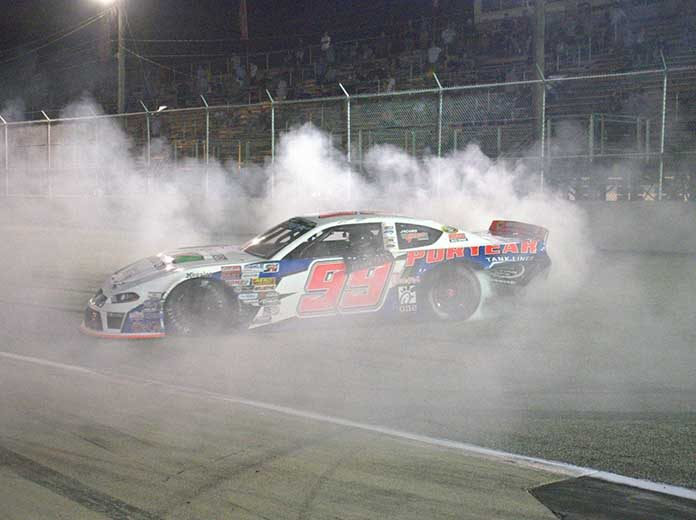 Layne Riggs celebrates with a burnout after his CARS Late Model Stock Tour victory Saturday at Langley Speedway.