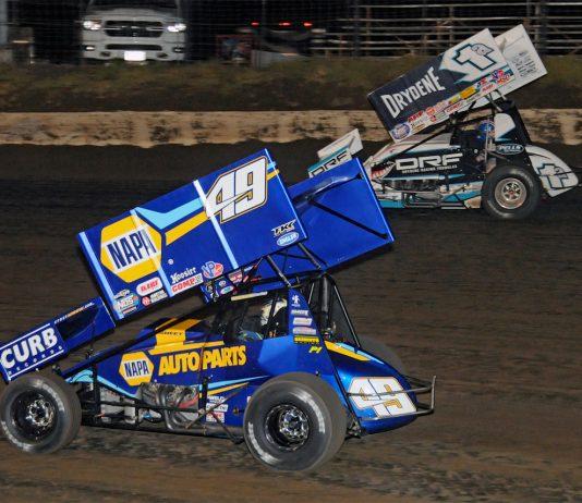 Brad Sweet (49) races under Jacob Allen at I-80 Speedway. (TWC photo)