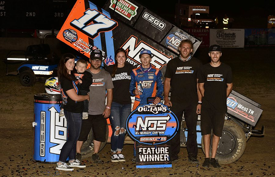 Sheldon Haudenschild poses in victory after winning Saturday's World of Outlaws NOS Energy Drink Sprint Car Series event at U.S. 36 Raceway. (Mark Funderburk Photo)