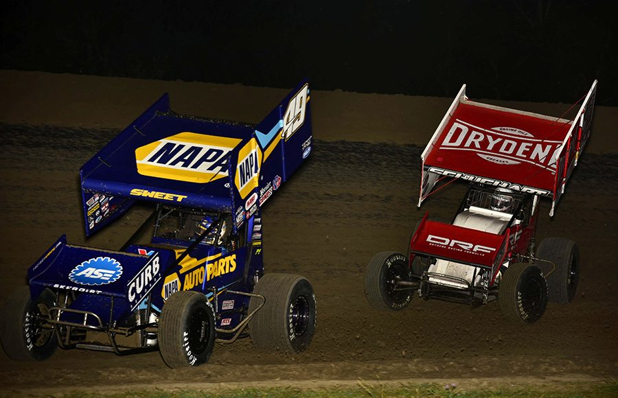 Brad Sweet (49) leads Logan Schuchart during Saturday's World of Outlaws NOS Energy Drink Sprint Car Series event at U.S. 36 Raceway. (Mark Funderburk Photo)