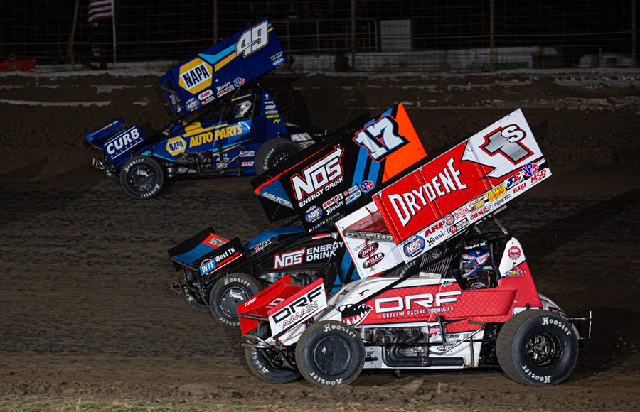 Logan Schuchart (1s), Sheldon Haudenschild (17) and Brad Sweet battle for position during Saturday's World of Outlaws NOS Energy Drink Sprint Car Series event at U.S. 36 Raceway. (Russell Moore Photo)
