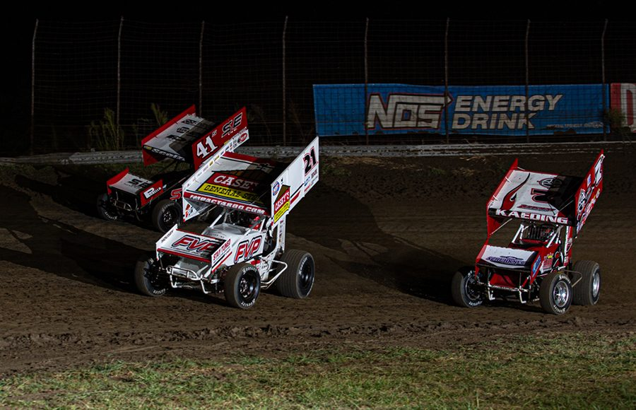 Brian Brown (21) races ahead of Dominic Scelzi (41) and Tim Kaeding during Saturday's World of Outlaws NOS Energy Drink Sprint Car Series event at U.S. 36 Raceway. (Russell Moore Photo)