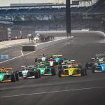 The Indy Pro 2000 field races into turn one Friday on the Indianapolis Motor Speedway road course.