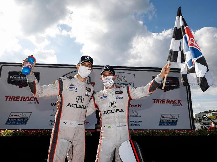 Helio Castroneves and Ricky Taylor came back from two penalties to win Saturday's TireRack.com Grand Prix at Michelin Raceway Road Atlanta. (IMSA Photo)