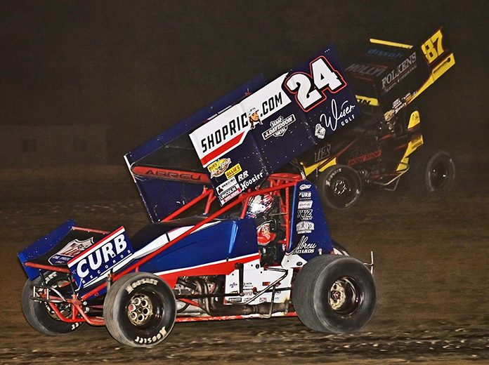 Rico Abreu (27) battles Aaron Reutzel Saturday night at Attica Raceway Park. (Mike Campbell Photo)