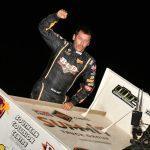Derek Hagar celebrates victory at Lake Ozark Speedway. (Ken Simon photo)