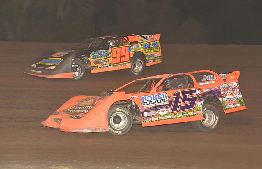 Justin Kay (15k) races under Darrel DeFrance during Monday's IMCA Speedway Motors Super Nationals late model championship feature at Boone Speedway. (Tom Macht Photo)