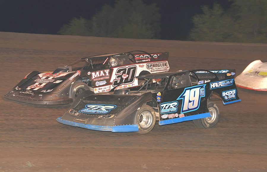 Richie Gustin (19) battles Ricky Thornton Jr. during Monday's IMCA Speedway Motors Super Nationals late model championship feature at Boone Speedway. (Tom Macht Photo)