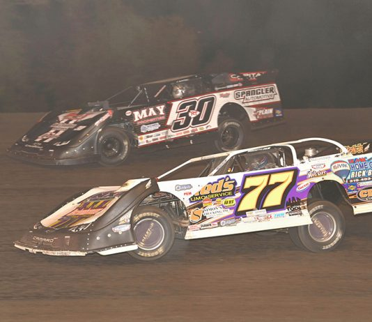 Jeff Aikey (77) and Ricky Thornton Jr. battle for the lead during Monday's IMCA Speedway Motors Super Nationals late model championship feature at Boone Speedway. (Tom Macht Photo)