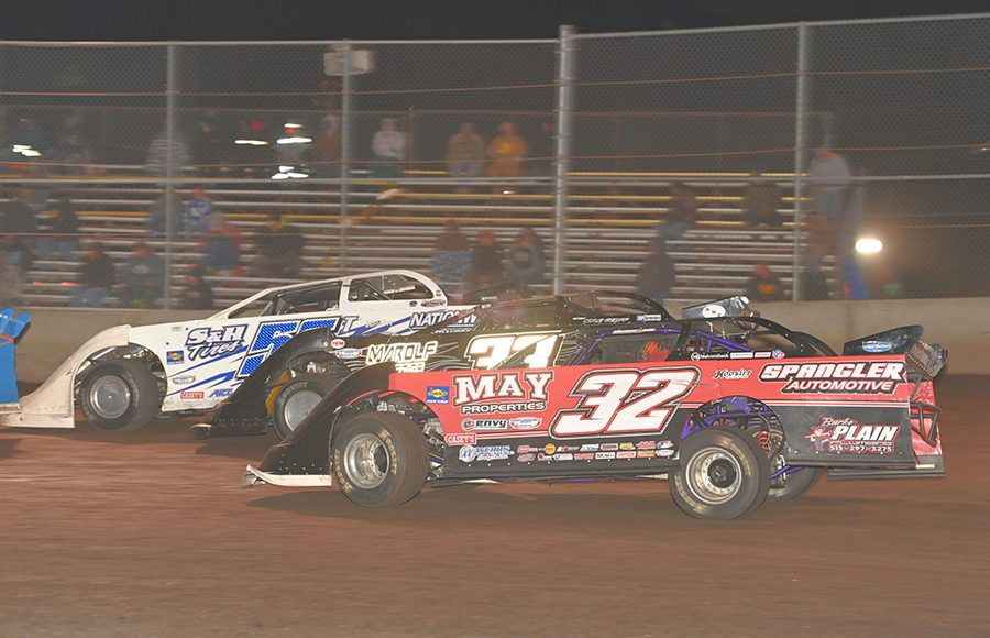 Andrew Tilley (56), Nick Marolf (33) and Curtis Glover battle three-wide during Monday's IMCA Speedway Motors Super Nationals late model championship feature at Boone Speedway. (Tom Macht Photo)