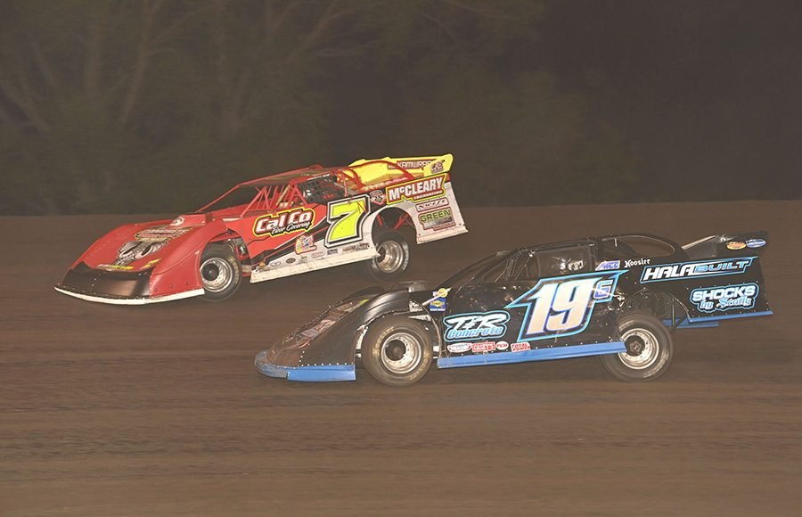 Richie Gustin (19) races to the inside of Andy Nezworski during Monday's IMCA Speedway Motors Super Nationals late model championship feature at Boone Speedway. (Tom Macht Photo)