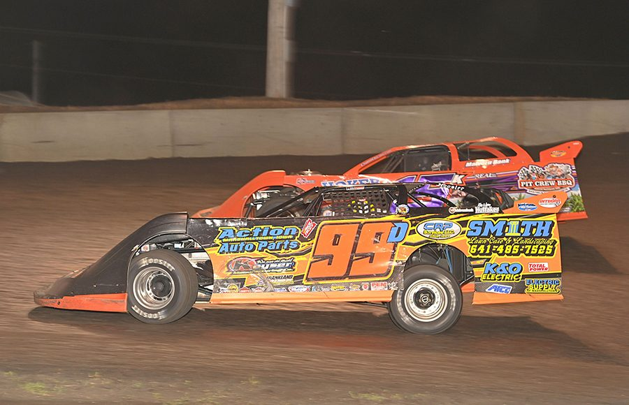 Darrel DeFrance (99) battles Justin Kay during Monday's IMCA Speedway Motors Super Nationals late model championship feature at Boone Speedway. (Tom Macht Photo)