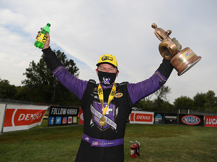 Jack Beckman celebrates his Funny Car victory in the U.S. Nationals on Sunday. (NHRA Photo)