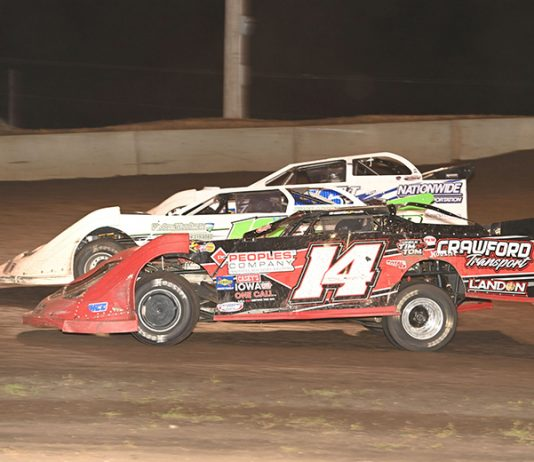 Drivers battle for position during Monday's IMCA Speedway Motors Super Nationals late model main event at Boone Speedway. (Tom Macht Photo)