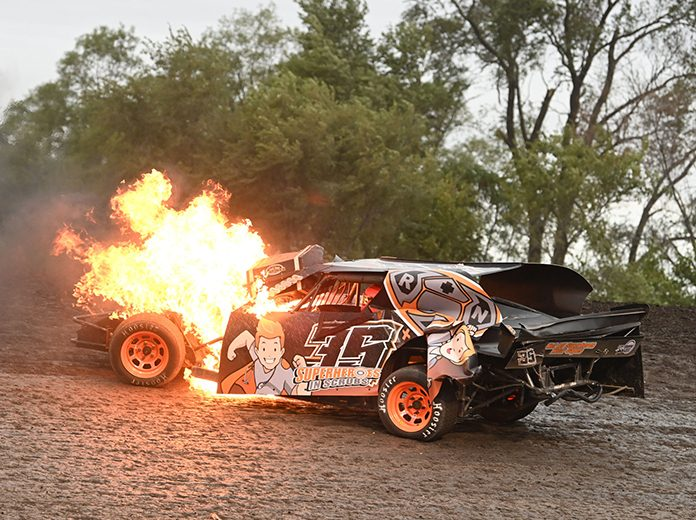 Chance Huston escaped injury in a bizarre accident Monday on the opening day of competition at the IMCA Speedway Motors Super Nationals. (Tom Macht Photo)