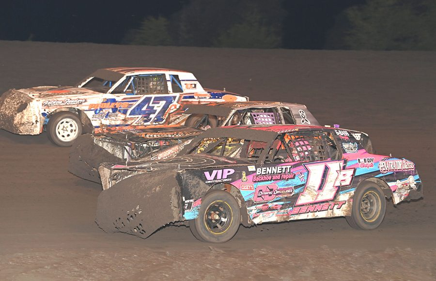 Solomon Bennett (11B) and Parker Anderson (47p) split another car during Wednesday's hobby stock qualifier during the IMCA Super Nationals at Boone Speedway. (Tom Macht Photo)