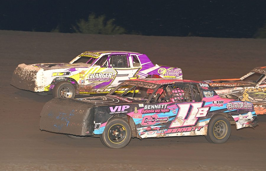 Solomon Bennett (11B) and David Carter race for position during Wednesday's hobby stock qualifier during the IMCA Super Nationals at Boone Speedway. (Tom Macht Photo)