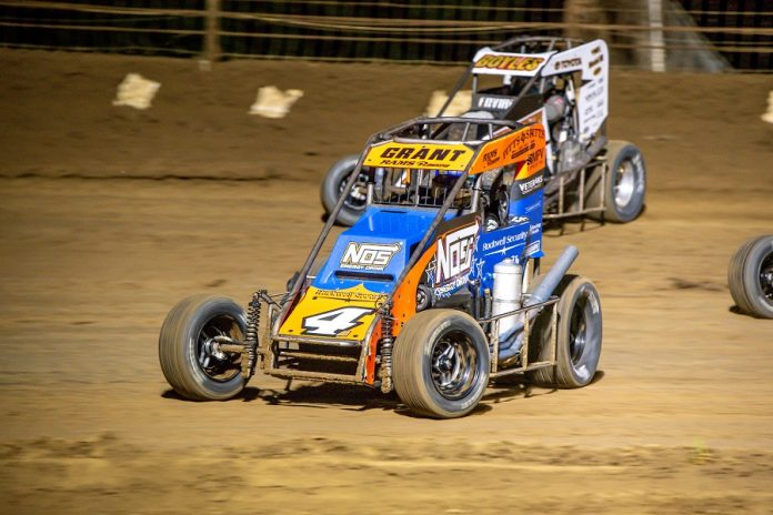 Justin Grant (4) dives underneath Clinton Boyles during Saturday's USAC National Midget Series feature at Sweet Springs Motorsports Complex. (Mark Coffman photo)